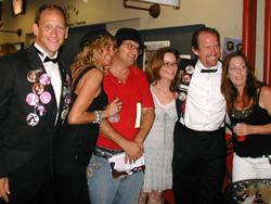 Ron, Jack (in tux/goatee) and members<br>of the Wild and Untamed Things<br>at the &quot;Confessions&quot; book party